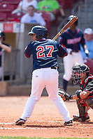 Cedar Rapids Kernels catcher Jairo Rodriguez #27 bats during a game against the Lansing Lugnuts at Veterans Memorial Stadium on April 30, 2013 in Cedar Rapids, Iowa. (Brace Hemmelgarn/Four Seam Images)