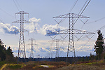 Power Lines and towers march across the landscape.  Sunny skes and scattered clouds.