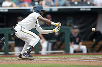 Michigan Wolverines outfielder Christian Bullock (5) squares to bunt during Game 1 of the NCAA College World Series against the Texas Tech Red Raiders on June 15, 2019 at TD Ameritrade Park in Omaha, Nebraska. Michigan defeated Texas Tech 5-3. (Andrew Woolley/Four Seam Images)