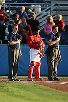 August 31, 2009:  Catcher Luis De La Cruz of the Batavia Muckdogs stands with base umpire Brian Debraywere and home plate umpire Jose Rivera during the National Anthem before a game at Dwyer Stadium in Batavia, NY.  The Muckdogs are the Short-Season Class-A affiliate of the St. Louis Cardinals.  Photo By Mike Janes/Four Seam Images