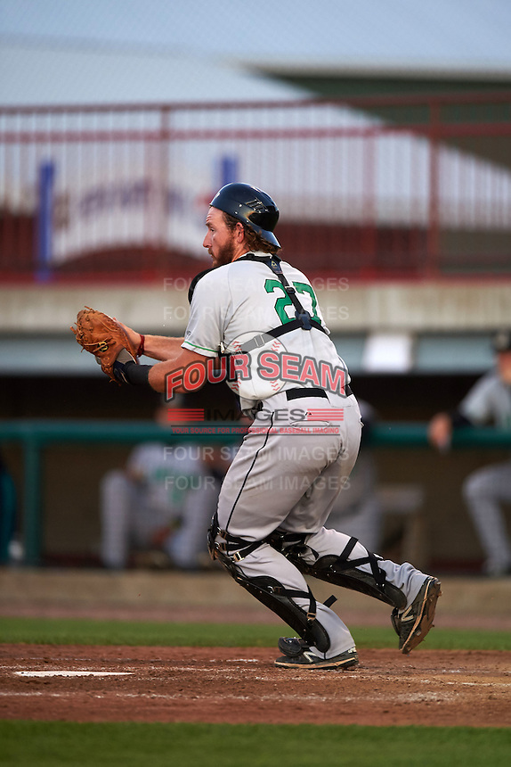 Clinton LumberKings catcher Adam Martin (27) fields a ball during a game against the Burlington Bees on August 20, 2015 at Community Field in Burlington, Iowa.  Burlington defeated Clinton 3-2.  (Mike Janes/Four Seam Images)