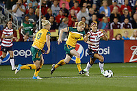 Commerce City, Colorado - Wednesday September 19, 2012; The US WNT defeated the National team of Australia 6-2 during an International friendly game at Dick's Sporting Goods Park.  Alex Morgan (13) and Clare Polkinghorne (4).