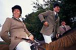 'DUKE OF BEAUFORT HUNT', FEMALE & MALE HUNT MEMBERS SITTING ON HORSEBACK, SHARING A JOKE WHILE WAITING FOR THE HUNT TO MOVE OFF