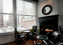 BOSTON, MA.-- February 19, 2010-- The upstairs restaurant and lounge with faux fireplace at The Ames Hotel. CREDIT: JODI HILTON FOR THE NEW YORK TIMES
