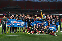 Northampton Town players and staff celebrate promotion to League One after a 4-0 victory in the Sky Bet League 2 PLAY-OFF Final match between Exeter City and Northampton Town at Wembley Stadium, London, England on 29 June 2020. Photo by Andy Rowland.