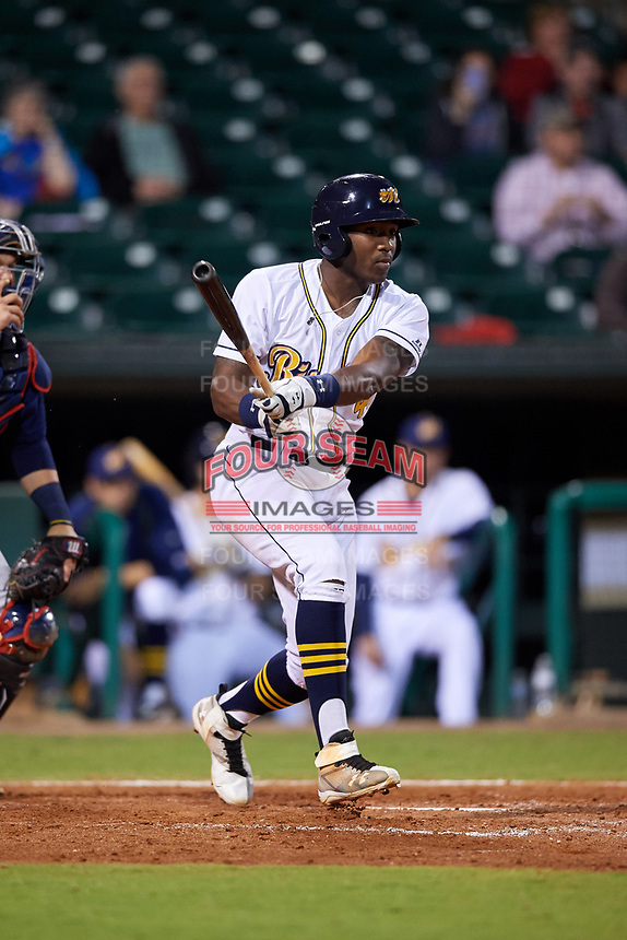 Montgomery Biscuits designated hitter Justin Williams (4) follows through on a swing during a game against the Mississippi Braves on April 24, 2017 at Montgomery Riverwalk Stadium in Montgomery, Alabama.  Montgomery defeated Mississippi 3-2.  (Mike Janes/Four Seam Images)