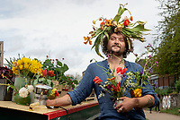 BNPS.co.uk (01202 558833)<br /> Pic: ZacharyCulpin/BNPS<br /> <br /> Pictured: 'The Floating Florist', Stuart Fenwick dons a flower crown in celebration of Garden Day. Stuart sells plants and flowers from his canal boat moored on Regent's Canal in Islington.  <br /> <br /> Londoners celebrate Garden Day by making flower crowns.<br /> <br /> Garden Day is back for a third successive year on Sunday, 9th May 2021 to celebrate outdoor and indoor garden spaces. The nationwide movement is called on plant-lovers to make a flower crown, and share their plant spaces with family and<br /> friends