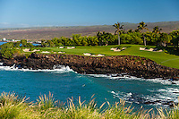 Hole No. 3 of the Mauna Kea Beach Hotel's golf course beyond a wave rolling into Kauna'oa Bay, Big Island.
