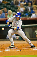 J.T. Riddle #10 of the Kentucky Wildcats drops down a bunt against the Rice Owls at Minute Maid Park on March 4, 2011 in Houston, Texas.  Photo by Brian Westerholt / Four Seam Images