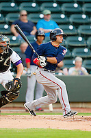 Mike Gilmartin (8) of the Potomac Nationals follows through on his swing against the Winston-Salem Dash at BB&T Ballpark on July 8, 2013 in Winston-Salem, North Carolina.  The Dash defeated the Nationals 12-9.  (Brian Westerholt/Four Seam Images)