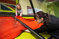 BNPS.co.uk (01202) 558833. <br /> Pic: TankMuseum/BNPS<br /> <br /> Pictured: The Swastika wall banner being installed. <br /> <br /> A Union Jack flag flown in defiance during the Siege of Tobruk is being displayed for the first time alongside a Nazi swastika flag captured during its liberation.<br /> <br /> The Allies held out for eight months in the face of an Afrika Corps onslaught until they were freed by the 8th Army in November 1941.<br /> <br /> The German commander Erwin Rommel was surprised by the aggressive attack, codenamed Operation Crusader, and forced to retreat at a pivotal juncture of the North African campaign.<br /> <br /> In the ensuing chaos, the swastika flag was captured from an 88mm flak gun locker by the advancing 8th Royal Tank Regiment.<br /> <br /> The flags will go on show from next month as part of the new World War Two: War Stories exhibition at the Tank Museum in Bovington, Dorset.