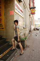 Model Released photo of a 21 year old asian (Chinese Filippina) in <br /> in Montreal's Chinatown, Canada<br /> <br /> photo : Roussel  - Images Distribution<br /> <br /> Model Released photo of a 21 year old asian (Chinese Filippina) listen to music on her MP3 player<br /> in Montreal, Canada<br /> <br /> photo : Roussel  - Images Distribution
