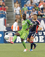 Seattle Sounders FC forward Eddie Johnson (7) volley pass as New England Revolution defender Flo Lechner (2) closes. In a Major League Soccer (MLS) match, the New England Revolution tied the Seattle Sounders FC, 2-2, at Gillette Stadium on June 30, 2012.