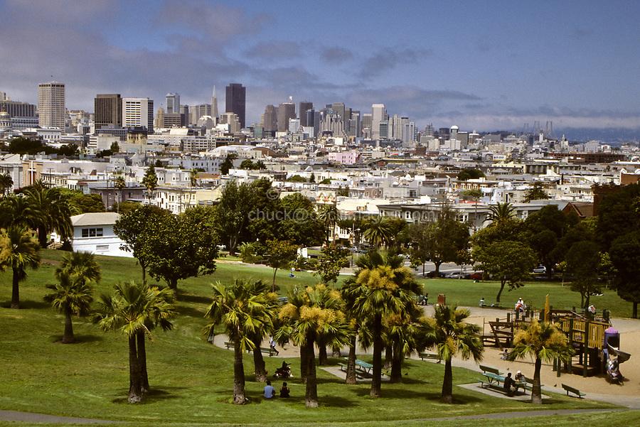 San Francisco, California - Cityscape from Mission Delores Park.  City Hall dome far left, Transamerica and Bank of America Buildings center-left, San Francisco-Oakland Bay Bridge on right.
