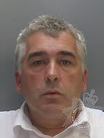 Pictured: Police custody picture of Keith Jones<br /> Re: The owner of a bus firm and his three sons were jailed by Mold Crown Court for fraudulently claiming tens of thousands of pounds for bus journeys which were never made.<br /> Express Motors owner Eric Wyn Jones and his sons Ian Wyn Jones, Keith Jones and Kevin Wyn Jones, claimed more than £88,000 from Gwynedd council for fake journeys using bus passes for the over 60s.<br /> All four had denied charges of fraud.<br /> Eric Wyn Jones, 77, was jailed for seven and a half years.<br /> Ian Wyn Jones, 53, was also sentenced to seven and a half years in prison, Kevin Wyn Jones, 54, was given seven years and Keith Jones, 51, was given six years.<br /> The men were also found guilty of putting more than £500,000 in cash through their own bank accounts without paying tax.<br /> Ian Wyn Jones admitted an additional charge of possessing £840 worth of counterfeit currency.