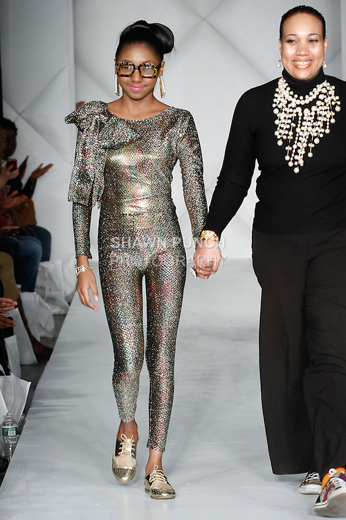 Young fashion designer Tyyan Williams, presents her Pinky Sez 2014 collection fashion show, during Fashion Week Brooklyn Fall Winter 2014, at Industry City, on March 15, 2014.
