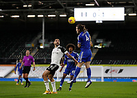 3rd February 2021; Craven Cottage, London, England; English Premier League Football, Fulham versus Leicester City; Caglar Soyuncu of Leicester City heads the ball over Aleksandar Mitrovic of Fulham