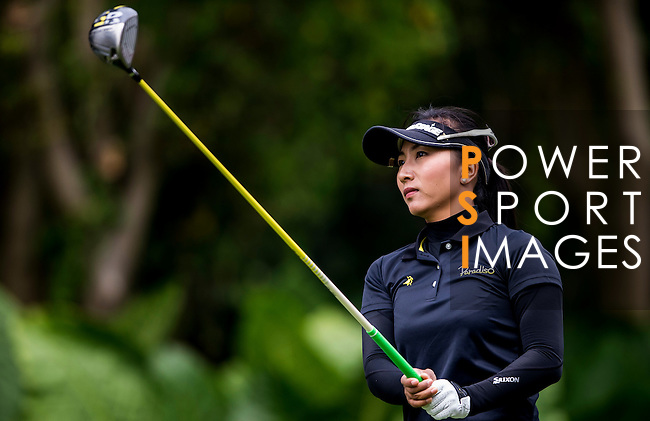 Hong Tian of China in action during the Hyundai China Ladies Open 2014 on December 12 2014 at Mission Hills Shenzhen, in Shenzhen, China. Photo by Li Man Yuen / Power Sport Images