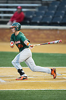 Carl Chester (45) of the Miami Hurricanes follows through on his swing against the Wake Forest Demon Deacons at Wake Forest Baseball Park on March 20, 2015 in Winston-Salem, North Carolina.  The Hurricanes defeated the Demon Deacons 15-2.  (Brian Westerholt/Four Seam Images)