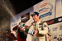 #7 Acura Team Penske Acura DPi, DPi: Helio Castroneves, celebrates on the podium with champagne