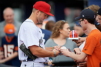Binghamton Rumble Ponies left fielder Tim Tebow (15) signs autographs and interacts with fans prior to a game against the Erie SeaWolves on May 14, 2018 at NYSEG Stadium in Binghamton, New York.  Binghamton defeated Erie 6-5.  (Mike Janes/Four Seam Images)