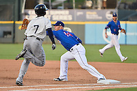 Tacoma Rainiers right fielder Xavier Avery (7) is ground out during pacific coast league baseball game, Saturday August 16, 2014 in Round Rock, Tex. Tacoma Rainiers win game one of the best of four series 8-7. (Mo Khursheed/TFV Media via AP Images)