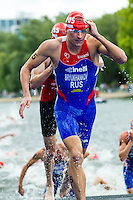 07 AUG 2011 - LONDON, GBR - Alexander Bryukhankov (RUS) runs from the water at the end of the swim during the men's round of triathlon's ITU World Championship Series .(PHOTO (C) NIGEL FARROW)