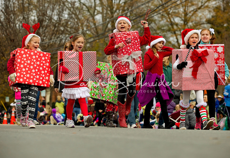 Thousands of spectators and participants in the Annual North Mecklenburg Christmas Parade held in the town of Davidson, NC. The annual parade includes marching bands, floats, tractors, fire trucks, Scouts, antique cars, clowns, pets and, of course, Santa Claus.<br /> <br /> Charlotte Photographer - PatrickSchneiderPhoto.com