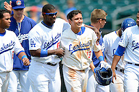 Chattanooga Lookouts outfielder Yasiel Puig #66 walks off the field with teammate Miguel Rojas #13 after Rojas game winning hit during a game against the Birmingham Barons on April 17, 2013 at AT&T Field in Chattanooga, Tennessee.  Chattanooga defeated Birmingham 5-4.  (Mike Janes/Four Seam Images)