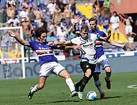 12th September 2021; G.Ferraris Stadium, Genoa, Italy; Serie A football, Sampdoria versus Inter Milan; Nicolo Barella of Inter is challenged by Tommaso Augello of Sampdoria