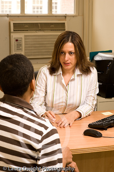 Education High School administrator working with or counseling male student