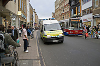 Ambulance on Emergency call driving through pedestrianed area of Oxford..This image may only be used to portray the subject in a positive manner..©shoutpictures.com..john@shoutpictures.com