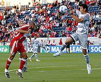 Chicago Fire defender C.J. Brown (2) heads the ball over leaping FC Dallas defender Alex Yi (21).  FC Dallas defeated the Chicago Fire 2-1 at Toyota Park in Bridgeview, IL on May 17, 2007.