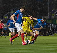 Fleetwood Town's Ched Evans (centre) under pressure from Portsmouth players has he battles for possession<br /> <br /> Photographer David Horton/CameraSport<br /> <br /> The EFL Sky Bet League One - Portsmouth v Fleetwood Town - Tuesday 10th March 2020 - Fratton Park - Portsmouth<br /> <br /> World Copyright © 2020 CameraSport. All rights reserved. 43 Linden Ave. Countesthorpe. Leicester. England. LE8 5PG - Tel: +44 (0) 116 277 4147 - admin@camerasport.com - www.camerasport.com