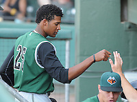 Outfielder Rafael Rodriguez (25) of the Augusta GreenJackets is congratulated after scoring a run in a game against the Greenville Drive on April 10, 2011, at Fluor Field at the West End in Greenville, S.C. Photo by Tom Priddy / Four Seam Images
