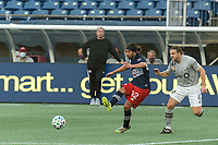 FOXBOROUGH, MA - SEPTEMBER 23: Lee Nguyen #42 of New England Revolution passes the ball as Samuel Piette #6 of Montreal Impact closes during a game between Montreal Impact and New England Revolution at Gillette Stadium on September 23, 2020 in Foxborough, Massachusetts.
