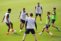 Raheem Sterling and some of the newer younger England players Jack Wilshere , Alex Oxlade-Chamberlain , Adam Lallana  and Luke Shaw are watched by Wayne Rooney