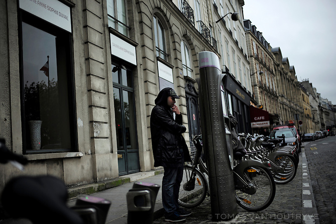 A client uses an automatic vending post to rent a Velib bicycle in Paris, France on May 21, 2013. The bikes can be rented inexpensively all across the city.