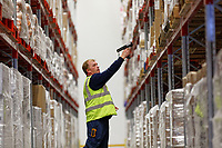 Pictured: A worker inside the warehouse. Wednesday 02 October 2019<br /> Re: An NHS Wales Warehouse in south east Wales is storing extra medical devices and consumables to ensure health and social services continue to run smoothly in the event of a no-deal Brexit.