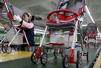 Workers on the assembly line at the Japanes-owned Combi Strollers factory in Tangxia, Dongguan City, Guangdong Province, China..26-MAR-04
