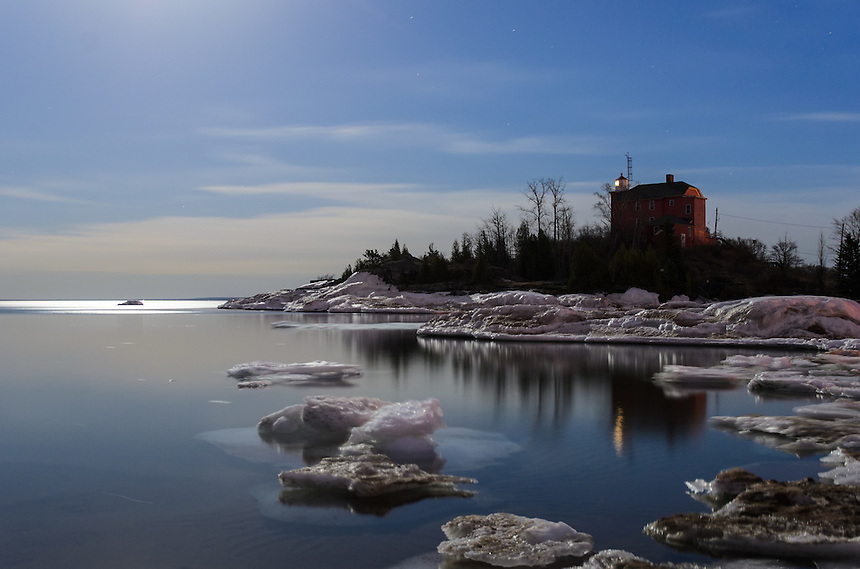 A bright spring moon illuminating Lake Superior and the Marquette Harbor Lighthouse. Marquette, MI