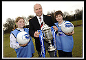 24/02/2009  Copyright Pic: James Stewart.File Name : sct_jspa04_scottis_cup.FORMER FALKIRK LEGEND ALEX TOTTEN SHOWS OFF THE HOMECOMING SCOTLAND SCOTTISH CUP TO SARAH JOHNSTON AND IAN MCARTHUR, PRIMARY SEVEN PUPILS AT ST MARGARET'S PRIMARY SCHOOL, POLMONT......Press Release..... A unique interactive tour to engage primary school children with football and the Homecoming Scottish Cup rolls into town today, Tuesday 24 February 2009 at St Margaret's Primary School in Falkirk.  . .Up to 100 pupils in primaries 5 to 7 at each local school will receive specialist skills and drill training from Scottish Football Association coaches as well as getting the chance to view the Homecoming Scottish Cup trophy itself.. .The school tour takes the form of a giant 'football-shaped' tent, which houses the world's oldest footballing trophy and information about Homecoming Scotland and the Scottish Cup tournament.. .Future football stars will be given soccer skills training ahead of watching their home team, Falkirk, take on Inverness Caledonian Thistle in the quarter finals of the Homecoming Scottish Cup on the weekend of 7 March.. .Falkirk legend Alex Totten, who used to manage the side, will be on hand at St Margaret's Primary School to share his knowledge and experience with the kids and to see the trophy himself.. .All primary schools in Scotland will also be sent education packs to encourage pupils to know more about Homecoming Scotland and to learn more about healthy eating, fitness and playing football as a way to keep fit and have fun.  . .As part of the football celebrations, the tour will then encourage locals in the town centre to get behind their local team, when the cup visits The Mall in Falkirk later in the afternoon.. .The Homecoming Scottish Cup Tour has been designed to engage with Scotland's local communities and spread the message about joining in the celebrations for Homecoming Scotland 2009, a programme comprising over 300 events to celebrate Scotland's culture, h