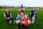 Mike, Hugh and Shay Moloney collect their Grow Your Own seeds from Dr Crokes GAA club on Friday with l-r:Eamon Fitzgerald, Sinead O'Mara, Matt O'Neill and Leah O'Neill-Standing