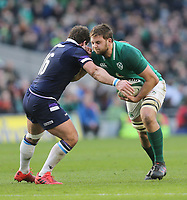 Saturday 10th March 2018 |  Ireland vs Scotland<br /> <br /> Iain Henderson on the attack is just caught by Fraser Brown during the NatWest 6 Nations clash between Ireland and Scotland at the Aviva Stadium, Lansdowne Road, Dublin, Ireland. Photo by John Dickson / DICKSONDIGITAL