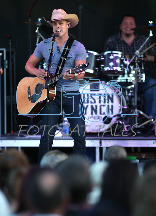 Dustin Lynch performs at the TJ's Corral Outdoor Events Center at the Carson Valley Inn in Minden, Nev., on Thursday, June 12, 2014.<br /> Photo by Cathleen Allisonn