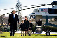 President Trump Returns to the White House<br /> <br /> President Donald J. Trump, joined by grandchildren Arabella, Theodore and Joseph Kushner, disembark Marine One on the South Lawn of the White House Sunday, Nov. 29, 2020, returning from Camp David near Thurmont, Md. (Official White House Photo by Tia Dufour
