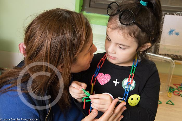 Education Preschool 4 year olds female teacher talking to girl
