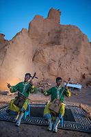 Mongolia, Gobi Gurvan Saikhan National Park, Gobi Desert, Flaming Cliffs. First nest of dinosaur eggs were found here in 1923. Music performance for dinner by Three Camel Lodge.