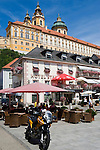 Austria, Lower Austria, Wachau, Melk: Old Town with Hotel Stadt Melk at Main Square surmounted by Benedictine Monastery Melk