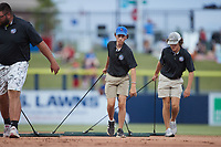 Members of the Kannapolis Cannon Ballers grounds crew drag the infield between innings of the game against the Charleston RiverDogs at Atrium Health Ballpark on July 1, 2021 in Kannapolis, North Carolina. (Brian Westerholt/Four Seam Images)